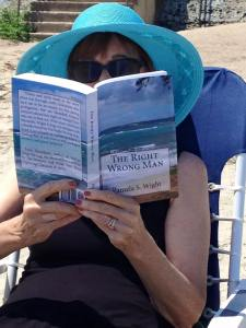 A reader (Nancy W.) enjoying The Right Wrong Man.