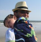 Father and son, nap time, at the beach