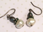 pearl earrings, pierced ears