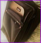 Tumi, suitcase, switched luggage