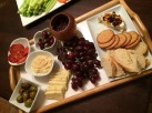 cheese platter, dinner party, poem